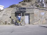 Standing at the summit of the Col du Tourmalet